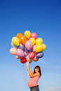 Beautiful happy young pregnant woman girl outdoors with balloons Royalty Free Stock Photo