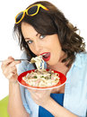 Beautiful Happy Young Woman Eating a Plate of Spaghetti Carbonara Pasta Royalty Free Stock Photo