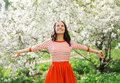 Beautiful happy young woman enjoying smell in a flowering spring garden Royalty Free Stock Photography