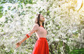 Beautiful happy young woman enjoying smell flowering spring garden Royalty Free Stock Photos