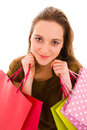 Beautiful happy young woman holding shopping bags. Royalty Free Stock Photos