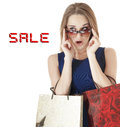 Beautiful happy young woman  holding shopping gift bags. Royalty Free Stock Image