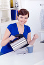 Beautiful happy young woman preparing tea at home Stock Photography