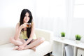 Beautiful happy young woman sitting with hot tea relaxed asian Stock Photos