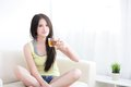 Beautiful happy young woman sitting with hot tea relaxed asian Stock Photo
