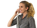 Beautiful happy young woman talking on the phone and smiling Stock Image