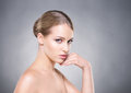 Beautiful healthy woman touching her cheek with her hand Royalty Free Stock Photo