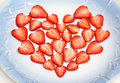 Beautiful heart symbol from chopped red juicy strawberry Royalty Free Stock Photo