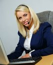 Beautiful help desk office support woman blond with headset Stock Image