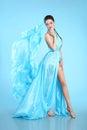 Beautiful High Fashion model in blue blowing chiffon dress. Glam Royalty Free Stock Photo