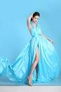 Beautiful High fashion woman in blue dress posing in studio. Gla Royalty Free Stock Photo