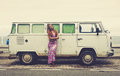 Beautiful hippie girl with retro bus in vintage style