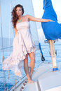 Beautiful hispanic female a model posing on a sailboat on lake michigan Royalty Free Stock Photos