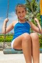 Beautiful hispanic girl riding a swing Royalty Free Stock Photo