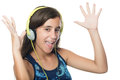 Beautiful hispanic teenager listening to music Royalty Free Stock Photo