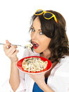 Beautiful Hispanic Young Woman Eating a Plate of Spaghetti Carbonara Cream Pasta Royalty Free Stock Photo