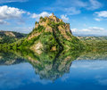 Beautiful historic castle on famous rock with crystal clear lake Royalty Free Stock Photo