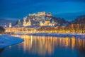 Beautiful historic city of Salzburg in winter at night, Austria Royalty Free Stock Photo