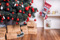 Beautiful holdiay decorated room with Christmas tree and presents under it. New Year decorations Royalty Free Stock Photo