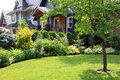 Beautiful home and garden surrounded by a lush perennial front Royalty Free Stock Image