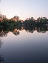 Beautiful hortizontal portrait of a lake with tree reflections d