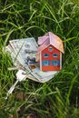 Beautiful house, dollar bills, keys Royalty Free Stock Photo