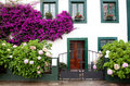 Beautiful house with with pots on their windows Royalty Free Stock Photo