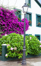 Beautiful house with  pots on their windows Royalty Free Stock Photo