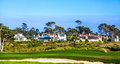 Beautiful houses near the pfeiffer pebble beach usa july at pebble beach golf course in pebble beach on july pebble beach is part Royalty Free Stock Image