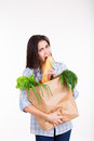Beautiful hungry  young woman holding paper bag Royalty Free Stock Photo