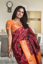 Beautiful indian girl in traditional indian sari red house background Stock Photography