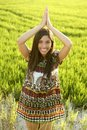 Beautiful indian woman in green rice fields Royalty Free Stock Photo