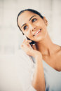 Beautiful indian woman using mobile phone happy smiling Stock Image