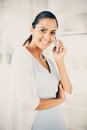 Beautiful Indian woman using mobile phone happy Royalty Free Stock Photo