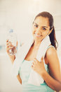 Beautiful indian woman water bottle fitness healthy happy young Royalty Free Stock Images