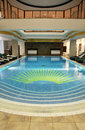 Beautiful indoor swimming pool in the hotel resort Royalty Free Stock Images
