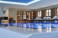 Beautiful indoor swimmingpool designed in spa hotel image taken from the ground with the relax chairs in background and Stock Photos