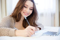 Beautiful inspired smiling young woman writing in notepad Royalty Free Stock Photo