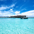 Beautiful island beach with motor boat Royalty Free Stock Images