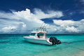Beautiful island beach with motor boat Stock Photography