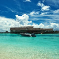 Beautiful island beach with motor boat at maldives Royalty Free Stock Photography