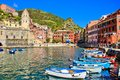 Beautiful italian coastal village colorful harbor with boats vernazza cinque terre italy Royalty Free Stock Images