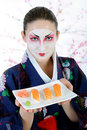 Beautiful japan geisha woman with sushi Royalty Free Stock Photos