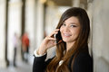 Beautiful japanese business woman in urban background on the pho portrait of phone Royalty Free Stock Image