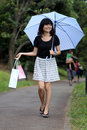 Beautiful Japanese girl walking with shopping bags Royalty Free Stock Photo