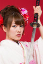 Beautiful japanese kimono woman with japanese sword Royalty Free Stock Images