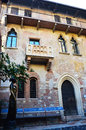 Beautiful Juliet balcony house with her staute in Verona, Italy Royalty Free Stock Photo