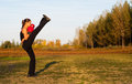 Beautiful kick boxing girl exercising high kick Royalty Free Stock Photography