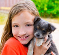 Beautiful kid girl portrait with puppy chihuahua doggy gray dog Royalty Free Stock Images