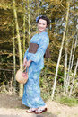 Beautiful kimono woman asian with bamboo grove Stock Photo